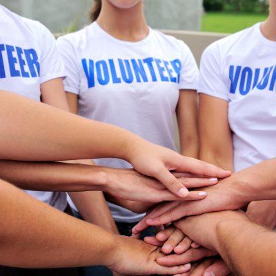 Image of volunteers shaking hands