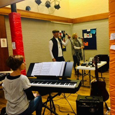 Image of band members practising in the Youth Centre Hall